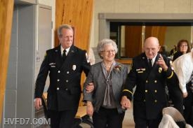 Juanita Johnson, escorted by her husband and son to receive her 60 year length of service award