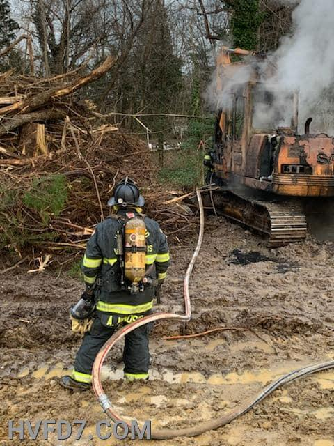 Crews from Engine 72, Tanker 74 and Truck 7 performing salvage / overhaul of the Excavator that was on fire when they arrived.