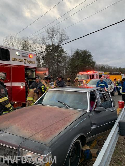 Crews from Rescue Squad 7, Engine 73, Squad 2 and E91 stabilizing the vehicle for extrication of one occupant.