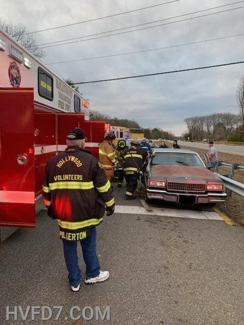 Crews from Rescue Squad 7, Engine 73, Squad 2 and E91 preparing for extrication of one occupant.