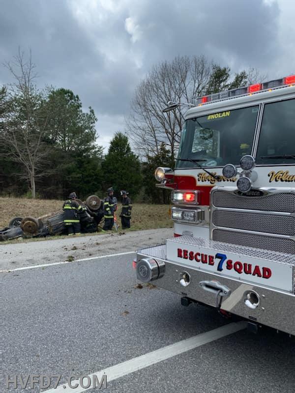 Rescue Squad 7 Crew Stabilizing Overturned Vehicle.