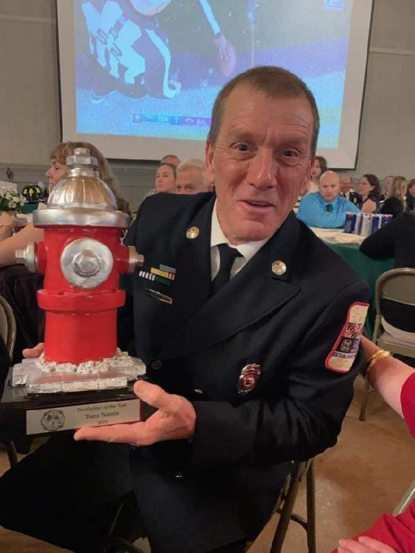 Engineer Tony Norris receiving his well-deserved award as the annual winner of the Maryland State Fire Fighter of the Year Award